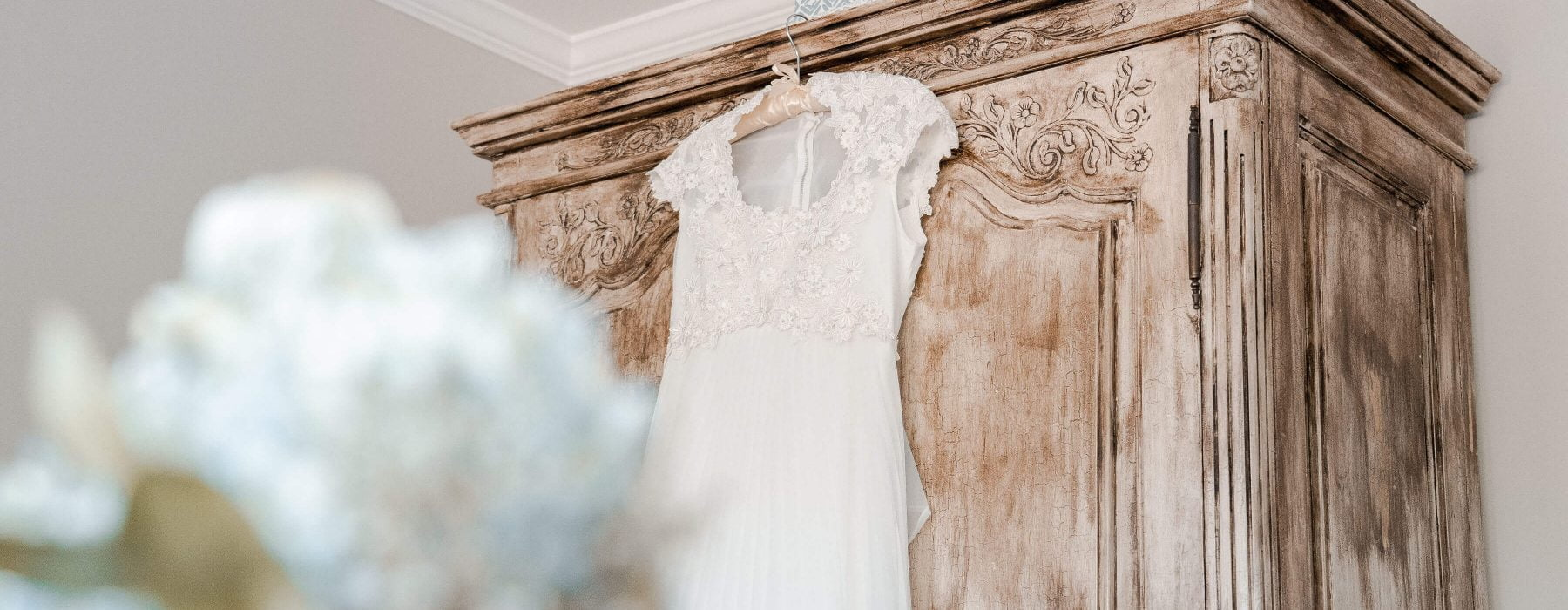 Ava House | Wedding dress on armoire