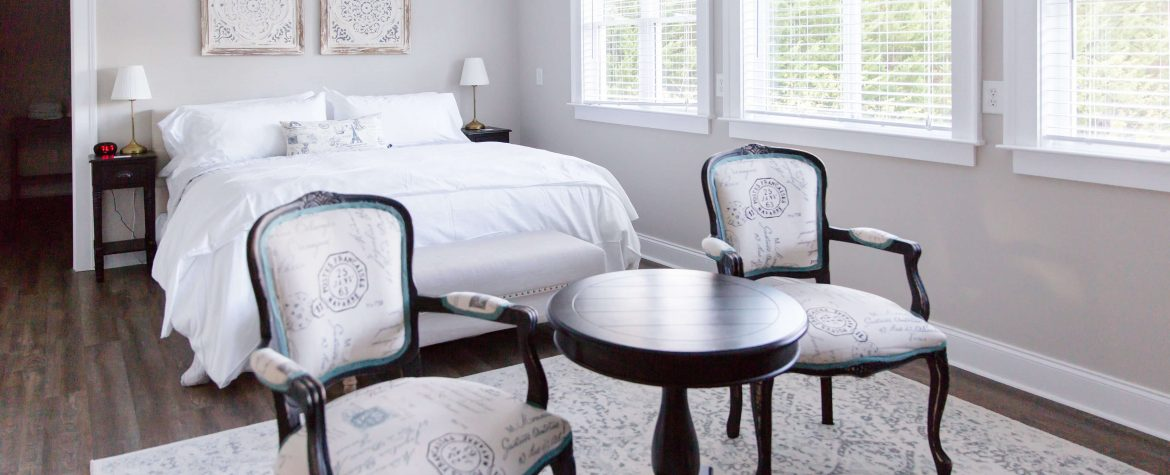 Ava House | Dahlonega, GA | Magnolia Room - view of seating area and bed
